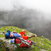 A Male Hiker Is Resting In A Grassy Art Print