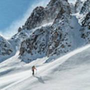 A Man Ski Touring In The Mountains Art Print