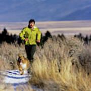 A Man Trail Runs On A Winter Day Art Print