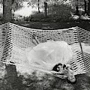 A Model Lying On A Hammock Art Print