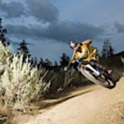 A Mountain Biker Rides A Trail Art Print