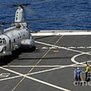 A Plane Captain Signals To A Ch-46e Sea Art Print