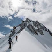 A Rope Team Climbs A Ridge Art Print