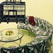 A Round Couch And A Birdcage Art Print
