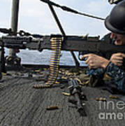 A Sailor Fires An M-240b Machine Gun Print by Stocktrek Images