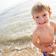 A Smiling Young Boy Enjoys A Sunny Art Print