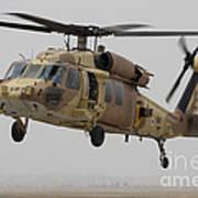 A Uh-60l Yanshuf Helicopter Landing Art Print