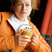 A Woman Enjoys A Warm Cup Of Cocoa Art Print