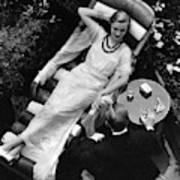 A Woman In A Chiffon Tea Gown In A Chaise Longue Art Print