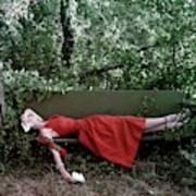A Woman Lying On A Bench Art Print