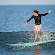 A Woman Rides A Wave On A Longboard Art Print