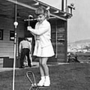 A Young Girl Hits A Golf Ball Art Print