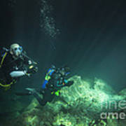 A Young Married Couple Scuba Diving Art Print by Michael Wood