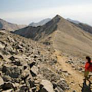 A Young Woman Hikes Borah Peak Art Print