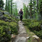 A Young Woman Walks Along An Sub-alpine Art Print