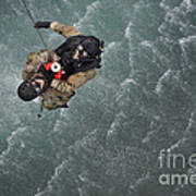 Airmen Are Hoisted Out Of The Water Art Print