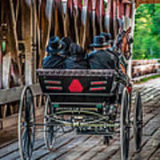 Amish Family On Covered Bridge Art Print by Gene Sherrill