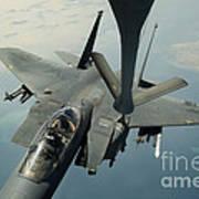 An F-15e Strike Eagle Receives Fuel Art Print