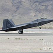 An F-22 Raptor Landing On The Runway Art Print