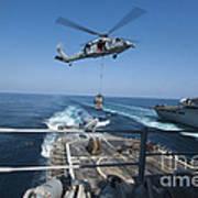 An Mh-60s Sea Hawk Brings Pallets Art Print