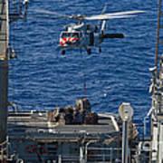 An Mh-60s Sea Hawk Delivers Supplies Art Print