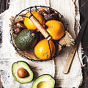 Basket With Avocado, Oranges And Dates Art Print