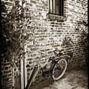 Bike In Pirates Alley Art Print by John Rizzuto