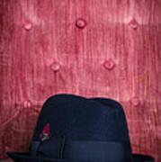 Black Hat On Red Velvet Chair Art Print
