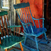Blue Chair Against Red Door Art Print