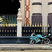 Blue Yellow Sporty Motorcycle Parked On Pavement Art Print