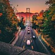 Blurred Motion Of Cars On Suspension Bridge During Sunset Art Print