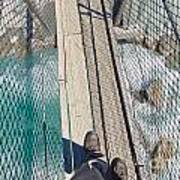 Boots On Swing Bridge Over Troubled White Water Art Print