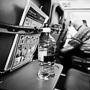 Bottle Of Water On Tray Table Interior Of Jet2 Aircraft Passenger Cabin In Flight Europe Art Print by Joe Fox