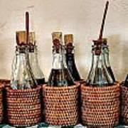 Bottles In Baskets Art Print