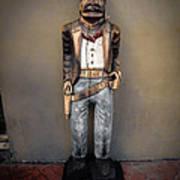 Bourbon Street Cigar Store Cowboy Print by Louis Maistros