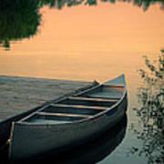 Canoe At A Dock At Sunset Art Print by Jill Battaglia