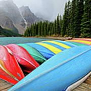 Canoes Line Dock At Moraine Lake, Banff Art Print