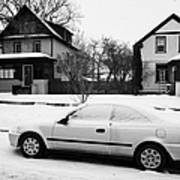 car covered in snow parked by the side of the street in front of residential homes caswell hill Sask Print by Joe Fox