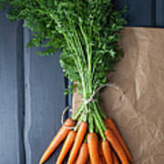 Carrots With Brown Paper On Wooden Art Print