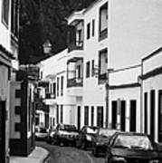 cars parked in a narrow tradtional cobble stone street in Garachico Tenerife Canary Islands Spain vertical Art Print