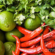 Chillies And Limes Art Print