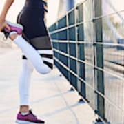 Close-up of woman stretching legs after running Art Print