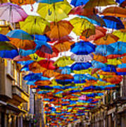 Colorful Floating Umbrellas Art Print by Marco Oliveira