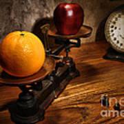 Comparing Apple And Orange Art Print
