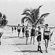 Couples Strolling Along The Pathway On The Beach. Art Print