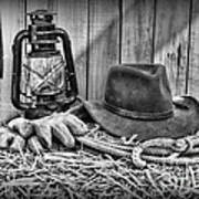 Cowboy Hat And Rodeo Lasso In A Black And White Art Print by Paul Ward