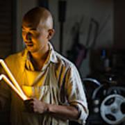 Craftsmen Holding A Lightning Bolt Shaped Neon Light Art Print