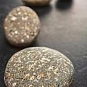 Curving Line Of Speckled Grey Pebbles On Dark Background Art Print