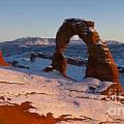 Delicate Arch With Snow At Sunset Arches National Park Utah Art Print