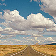 Desert Road With Cloud Formations Above Art Print